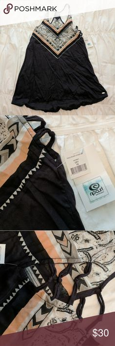 NWT RIPCURL Beach Cover This cute piece can be worn as a shirt or dress. Knots on side for airy sexy look. Cool pattern on front and back brand new with tags Rip Curl Swim