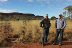 AWC's Tim Allard and Newhaven manager Joe Schofield at the feral cat proof fence line