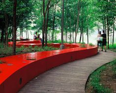 The Red Ribbon (Tanghe River Park) uses minimal intervention to turn nature into aesthetically attractive, urban green space. Against the background of natural terrain and vegetation, the landscape architect placed a 500-meter, red-ribbon bench integrating lighting, seating, environmental interpretation and orientation.