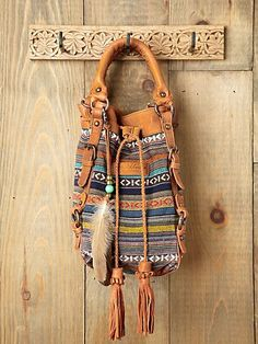 bohemian leather satchel with feather accent