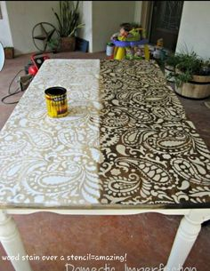 Wood stain over a stencil makes a beautiful table or you could also do this to a dresser