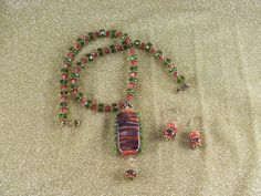 Hand made focal bead with hand made accent beads.  #designsbynanette