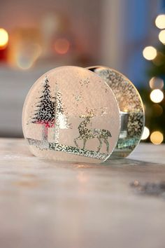 Reindeer & Tree Tealight £7.00 Glass tealight holder featuring a frosted reindeer and tree winter scene. Measures H9 x W11 x D6cm. Tealight not included - see page 30 for tealights.