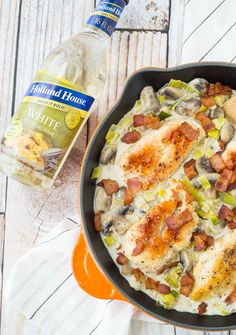 This Skillet Chicken with Mushrooms, White Wine, Bacon and Leeks is creamy, rich and so easy to make! Perfect for entertaining or every day dining. Get the easy recipe on RachelCooks.com!