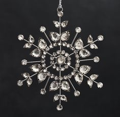 "Restoration Hardware: Victorian Glass Snowflake in ""Flower"" / ""Hand-inset with faceted rhinestones and glass beads, our delicate snowflakes shimmer with light as they hang on the tree, just like the Victorian-era ornaments that inspired them."""