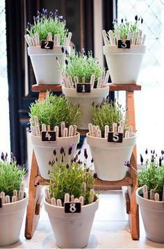 Unique flower pot seating chart idea for a wedding reception!