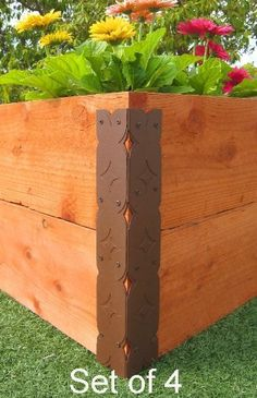 """Raised Garden Bed Corner Brackets (Designer) - For 20""""H Beds by Gardens To Gro. $47.00. Set of four brackets - includes matching screws. Unique lumber channel inside bracket makes installation EASY. Get the straight and sturdy corners of professional-looking garden beds. Attractive design, made of powder-coated steel. Designed to fit two 2""""x10"""" rough lumber boards - stacked to build 20"""" high garden beds. 20"""" high beds are ideal for those who'd rather not stoop. T..."""