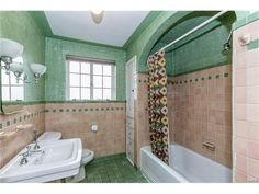 What a lovely pink and mint green tiled Art Deco style Bathroom.