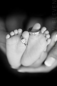 Baby's feet with mommy and daddy's wedding rings