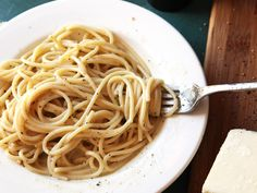 If you were to watch a practiced hand make cacio e pepe, you might think the instructions were as simple as this: Cook spaghetti and drain. Toss with olive oil, butter, black pepper, and grated Pecorino Romano cheese. Serve. But we all know that the simplest recipes can often be the most confounding, and so it is with cacio e pepe. Here's how to make it perfectly every time.