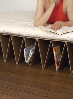 Extra bed made of collapsible cardboard
