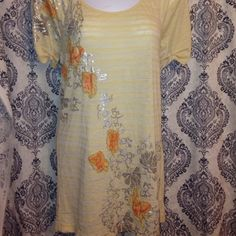 Free people cute top Soft yellow top with orange & green butterfly's. Pretty silver floral designs. Free People Tops Tunics