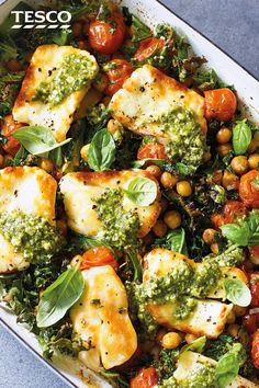 Add this baked halloumi with chickpeas and greens to your summer meal plans. Melting halloumi, crispy chickpeas and sweet juicy tomatoes are finished with a drizzle of pesto for dinner in under 30 mins. Vegetarian Dinners, Vegetarian Recipes, Cooking Recipes, Healthy Recipes, Cooking Cake, Cooking Tools, Veggie Dinners, Cooking Ideas, Baked Halloumi