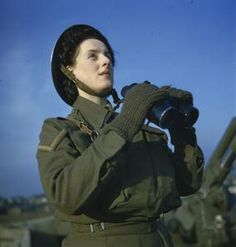 An Auxiliary Territorial Service (ATS) spotter with binoculars at an anti-aircraft command post, December 1942.