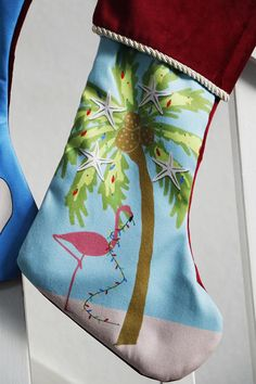 This listing is for 1 Flamingo and Palm Tree Christmas Stocking The design is digitally drawn by me (Helen Irene) The stocking features the design on the front and red fleece on the back. The stocking is made out of a thick red plush fleece, with a microfiber front surface where