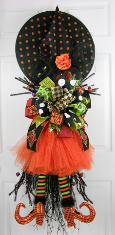 Witch with tutu on broom with large Terri Bow by MilandDil Designs Designer Terri Marshall. Shop our Halloween Collection!