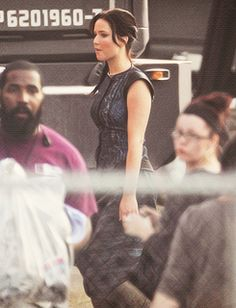 Jen on 'Catching Fire' set wearing, the rumored, parade chariot outfit.