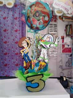 Toy story centerpiece Toy Story Birthday Cake, Woody Birthday, Boys 1st Birthday Party Ideas, Baby 1st Birthday, Toy Story Centerpieces, Birthday Centerpieces, Toy Story Theme, Toy Story Party, Buzz Lightyear