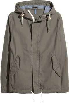 H&M - Canvas Parka - Khaki green - Men, Parka in washed cotton canvas with lined drawstring hood. Zip and wind flap with concealed snap fasteners at front, side pockets with flap and snap fastener, and tab and snap fastener at cuffs. Drawstring at hem. Unlined.
