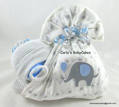 Stork bundle baby diaper cake for an elephant themed baby shower!  I love creating and customizing these adorable sleeping diaper babies!