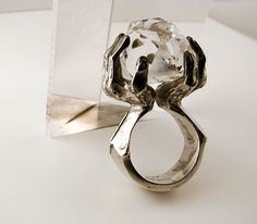 Hands holding stone ring -