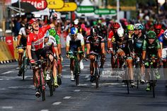 Andre Greipel (L) of Germany and Lotto-Soudal celebrates as he crosses the finish line to win the twenty first stage of the 2015 Tour de France, a 109.5 km stage between Sevres and Paris Champs-Elysees, on July 26, 2015 in Paris, France. #TDF2015 #rm_112