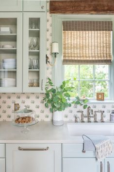 Light green kitchen cabinets with a traditional backsplash. Kitchen Nook Table, Kitchen Decor, Kitchen Ideas, Cottage Kitchens, Home Kitchens, Green Cabinets, Kitchen Cabinets, Colored Cabinets, Glass Cabinets