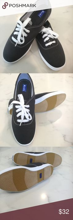 NWT Women's Navy Canvas Champion Lace Ups New in box, never worn! Champion Navy blue canvas. White lace ups. Tan striped bottom sole. Keds brand. Women's size 7.5 Keds Shoes Sneakers