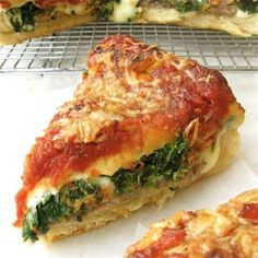 Stuffed Pizza recipe. This tasty home-style pizza, is stuffed with cheese, spinach, and topped with onions, green peppers etc. It's excellent! Posted by Nazia Nazar.