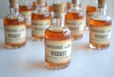 Personalised cork bottle with whisky as wedding favors for male guests