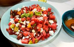 Summer in a bowl: salty and sweet, with a hint of acidity. Make it with the best tomatoes you can find, a cold watermelon, less dressing than you would think and, if you can find it, Bulgarian feta.
