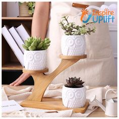 Owl Wooden Tree #inspireuplift #bamboo #beautiful #ceramic #charm #birthday #addition #bird #cactus #cacti  This simple yet beautifully elegant set of three, white, ceramic owl planters, complete with staggered tree stand makes a gorgeous addition to any home decor! The small owl planter pots sitting on their branches make the perfect display piece for any small cacti or succulents. Decorate any room in your home with this unique and charming bamboo shelf and owl planter pots. The Owl Wooden…