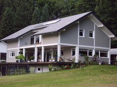 """www.architecture-bois.be : Maison ossature bois de style """"louisiane"""" recouverte d'un bardage peint"""