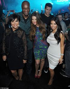 Still part of the family: Kris, Lamar and Khloe are pictured here with Kim Kardashian and ...