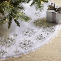 With A Sheer Silver Overlay Of Embroidered And Beaded Snowflake Embellishments Fluffy White Base Our Luxe Handcrafted Tree Skirt Helps Transform