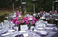 like the design of this centerpiece low with higher floating candles.  Purple is a little dark but like the style