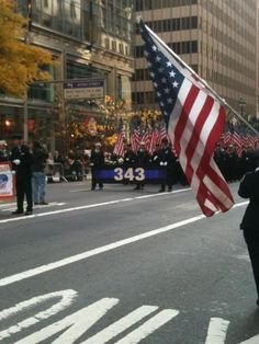 Veteran's Day Parade in NYC, FDNY - 343 American flags are carried, each one for a fallen firefighter on 9/11 - amazing sight to see.