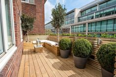 Belgravia A  fourth-floor flat with a decked roof garden/terrace area, featuring an attractive L-shaped seat in the corner. The property is situated at the rear of its block, with views into a communal garden. £2.75m, John D.Wood & Co.