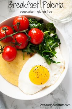This savoury polenta breakfast bowl is a nice switch up to morning outs. Creamy parmesan polenta is topped with sauteed tomatoes and spinach along with a fried egg in this comforting recipe. Vegetarian and gluten free! Clean Eating Vegetarian, Clean Eating Recipes, Vegetarian Recipes, Healthy Recipes, Free Recipes, Vegetarian Diets, Vegetarian Breakfast, Egg Recipes, Healthy Food