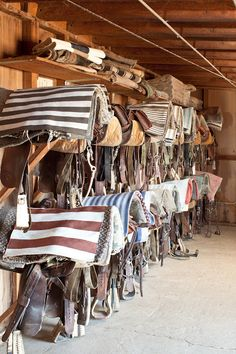 I'd like a tack room like this (including the clean saddle blankets!) and a barn full of horses :)