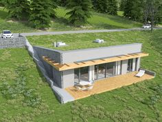 A green roof or living roof is a roof of a building that is partially or completely covered with vegetation and a growing medium, planted over a waterproofing. Small House Design, Modern House Design, Green Architecture, Architecture Design, Residential Architecture, Contemporary Architecture, Houses On Slopes, Earth Sheltered Homes, Earthship Home