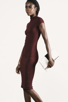 Right Said Fred Dress - This classic cut bodycon dress comes with a mock turtleneck and short sleeves. The fitted dress is made from soft rayon rib and features an oval cut out in the back which gives this little number some pretty sex appeal.  You'll be looking just right said Fred! Available in Burgundy.