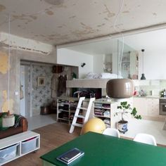 Karin Matz leaves unfinished plaster walls  in renovated Stockholm apartment