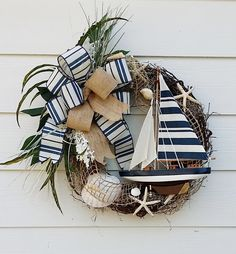 Handmade Sailboat Wreath, Ocean Wreath, Beach House Wreath, Lake House Wreath,  Door Wreath, Wall Decor, Nautical Wreath, Sea Shell Wreath by TheChicyShackWreaths on Etsy https://www.etsy.com/listing/226309894/handmade-sailboat-wreath-ocean-wreath