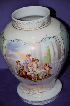 ROYAL AUSTRIA USED WITH PATTERN WEAR VASE, 10 INCHES TALL..