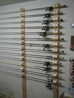 Ceiling Mounted Rod Holder Need to create my own very similar to this. Diy Fishing Rod Holder, Fishing Pole Storage, Kayak Storage, Pvc Rod Holder, Diys Room Decor, Wall Decor, Pole Holders, Rod Rack, Fishing Tackle
