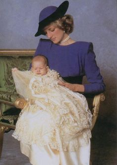 Diana with Harry at his December 1984 christening. He is wearing the Honiton lace robe
