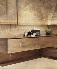 Vaselli Le Cave Bathroom System in Noce Travertine.