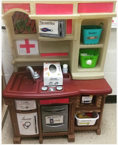 preschool dramatic play center: transform a play kitchen into a doctor/veterinarian office