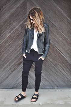 Heavy Birkenstock, black tight pants, white shirt and black leather jacket